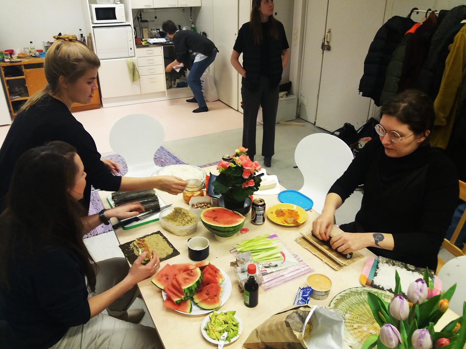 People preparing food at the Poimu kitchen
