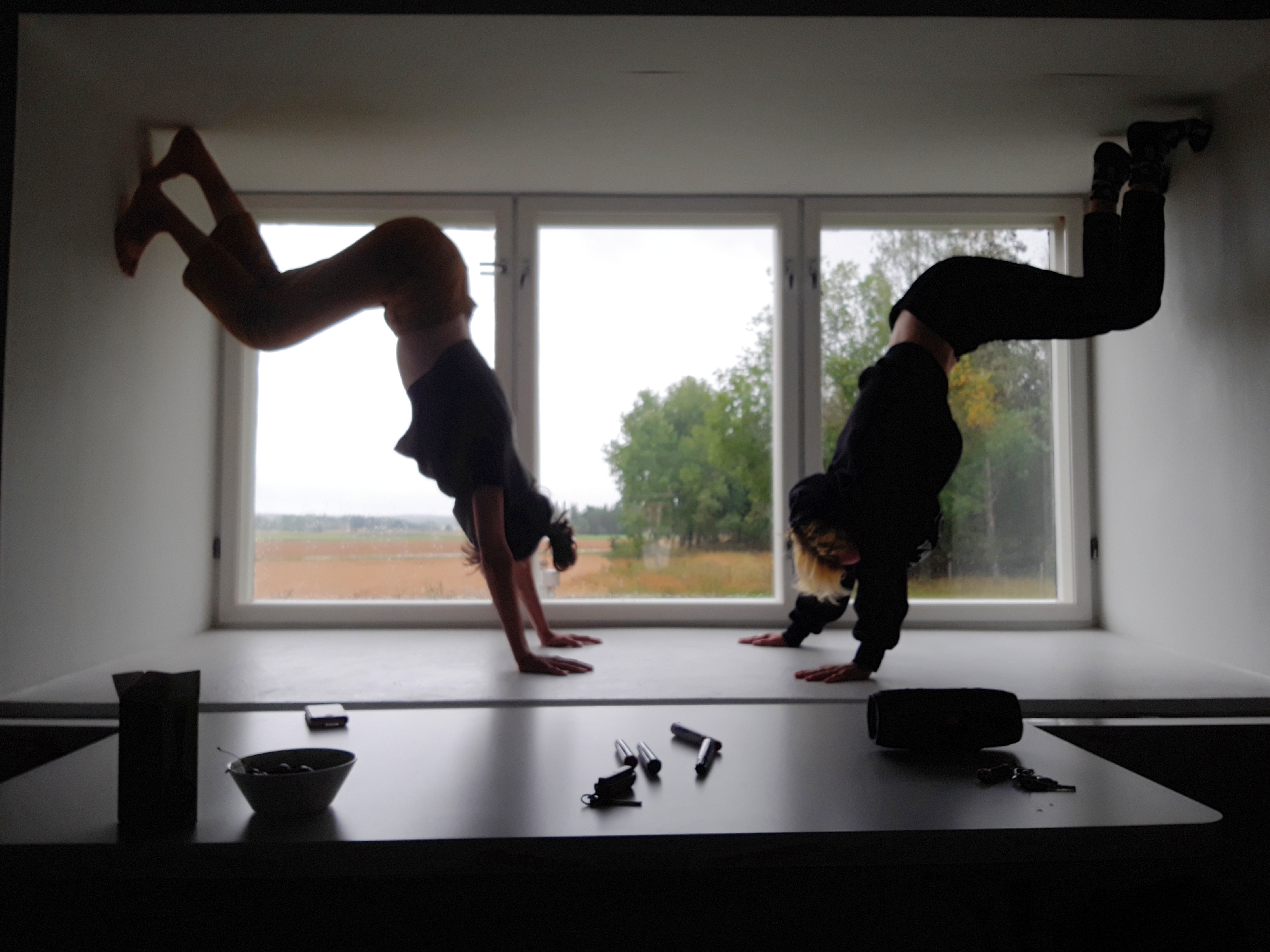 nynnyt stretching and attempting handstand on a table by the window