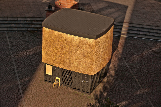 a building made out of different types of wooden material, pictured from above